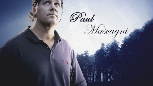 Paul Mascagni stands in front of the woods
